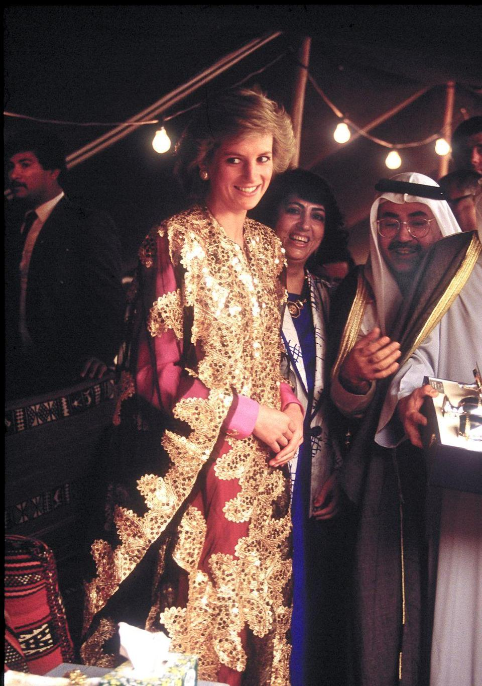 <p>In a red-and-gold embroidered gown during her visit to Kuwait. </p>