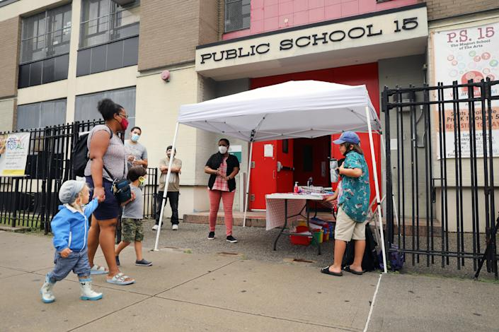 City council members, parents and students participate in an outdoor learning demonstration in front of a public school in the Red Hook neighborhood on September 02, 2020 in the Brooklyn borough of New York City. (Spencer Platt/Getty Images)