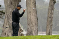 Tiger Woods toss a ball down on the 17th hold during a practice round for the PGA Championship golf tournament at TPC Harding Park Wednesday, Aug. 5, 2020, in San Francisco. (AP Photo/Charlie Riedel)