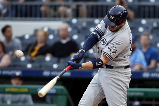Milwaukee Brewers' Mike Moustakas hits a two-run home run off Pittsburgh Pirates starting pitcher Joe Musgrove during the first inning of a baseball game in Pittsburgh, Thursday, May 30, 2019. (AP Photo/Gene J. Puskar)