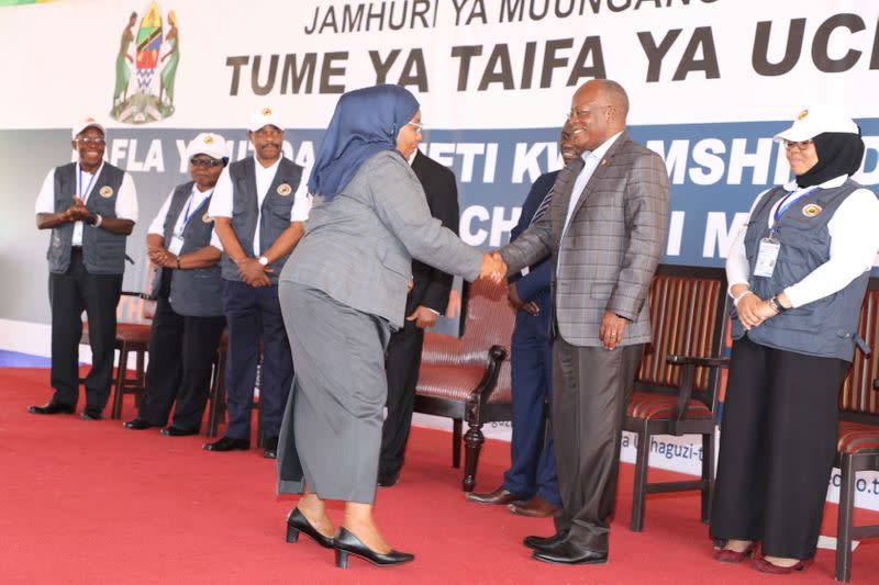 Tanzania's re-elected President John Pombe Magufuli greets Tanzania's Vice President Samia Suluhu Hassan after receiving the winning certificate at the National Electoral Commission (NEC) headquarters in the Njedengwa suburb of Dodoma