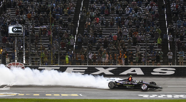 FILE - In this June 8, 2019, file photo, Josef Newgarden celebrates winning the IndyCar auto race at Texas Motor Speedway in Fort Worth, Texas. IndyCar has gotten the green flag to finally start its season in Texas. The race will be run June 6 without spectators at Texas Motor Speedway. (AP Photo/Randy Holt, File)