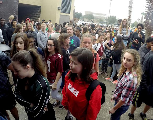 <p>Students from Choctawhatchee High School in Fort Walton Beach, Fla. gather outside the school to honor the lives lost from the high school shooting last week, Friday, Feb. 23, 2018. (Photo: Nick Tomecek/Northwest Florida Daily News via AP) </p>