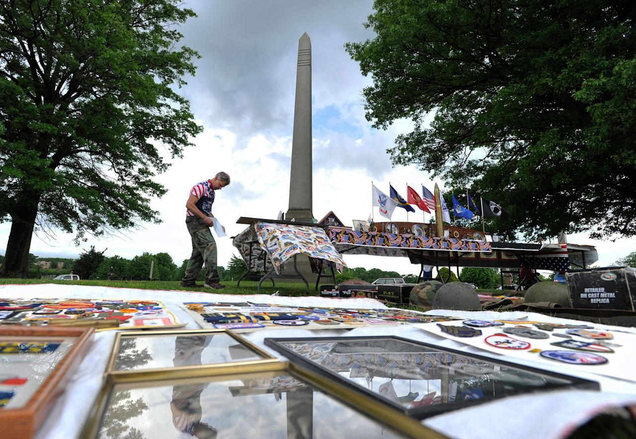 <p>Marty Malek, of Johnstown, puts out his personal collection of World War I and II war artifacts for display at the Westmont Boro Memorial Day ceremony at Johnstown Grandview Cemetery, Monday, May 29, 2017. (Photo: Todd Berkey/The Tribune-Democrat via AP) </p>