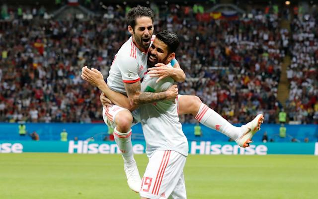 "Diego Costa scores only goal to break stubborn Iran defence Iran have equaliser correctly ruled out on VAR for offside Cristiano Ronaldo saves lucky Portugal to send Morocco out Luis Suarez nudges unconvincing Uruguay into second round Cesc Fabregas column: My 18-year friendship with Messi Spain were grateful for a huge slice of luck on Wednesday night as they overcame a stubborn Iran side to claim a 1-0 win. Diego Costa scored the winner after 54 minutes when he was tackled by Ramin Rezaeian, only for the ball to ricochet back off Costa's shin and into the back of the net. Iran thought they had equalised shortly after but, following a VAR intervention, Saeid Ezatolahi's bundled effort was correctly ruled out for offside. Mehdi Taremi then headed over in the closing stages as Iran were forced to abandon their ultra-defensive approach. The win takes Spain joint top of Group B with Portugal on four points, while Iran sit just below them with three points. The final group games take place on Monday, with Spain against Morocco and Iran taking on Portugal. 9:11PM Tight at the top This is what it all means for the Group B table. All to play for (unless you are Morocco)... 9:08PM History (sort of) 1-0 - Iran 0-1 Spain means that all three matches today ended in a 1-0 scoreline. The only other days in World Cup history to see three 1-0 wins in a single day were June 25th 1982 (3) and June 23rd 2010 (3). Narrow.#IRNESP#IRN#ESP#WorldCup— OptaJoe (@OptaJoe) June 20, 2018 0 - There have been no 0-0 draws in any of the 20 games at the 2018 World Cup so far - the last time that this happened was in 1954 (no 0-0's in the 26-game tournament). Goals.#IRNESP#ESP#IRN#WorldCup— OptaJoe (@OptaJoe) June 20, 2018 9:05PM Full-time stats Iran vs Spain shots on goal Iran vs Spain Average touch positions (full time) 8:58PM Analysis Spain did it. They finally broke Iran down, courtesy of a big ricochet and a goal that Costa knew very little about. Iran defended resolutely and could even have shared the points. They, correctly, had a goal disallowed and came close a couple of times late on. As it is, there is all to play for with everyone to play one more game in the group. 8:54PM Full time Iran 0 Spain 1 8:54PM 90+3 mins - Iran 0 Spain 1 A long lump fails to find an Iranian player. And again. They are trying, without having anything fall for them. Here comes a long throw, though... Mohammadi will fling the ball into the Spain box. He gives it a kiss, then does a somersault and bails out! What on earth was that?!? His second attempt is to a player nearby instead and the move peters out. 8:51PM 90+2 mins - Iran 0 Spain 1 Ebrahimi is shown yellow for a foul on Rodrigo and that means Spain have a free-kick about 25 yards out on the left flank. Isco takes, but it fails to beat the first Iranian defender. Plenty of time was wasted, though. 8:49PM 90 mins - Iran 0 Spain 1 Spain are keeping possession smartly now, with Iran run-ragged from all of their defensive work earlier in the match. Four minutes of stoppage time to be played. 8:48PM 88 mins - Iran 0 Spain 1 Costa's night is up, to be replaced by the Valencia striker Rodrigo. 8:46PM 87 mins - Iran 0 Spain 1 Back to front, front to back from Spain. That will take up another minute. Almost there. Credit: getty images 8:44PM 85 mins - Iran 0 Spain 1 Spain just need to take the sting out of this now. Or score again. One of those two things, you know. 8:42PM 83 mins - Iran 0 Spain 1 That is an enormous chance for Iran!!!! Amiri nutmegs Pique on the left and delivers a sublime cross to Taremi at the far post. He rises to meet the ball inside the six-yard box and has a whole heap of goal to aim at, but his header flies over the bar. So close. So very close. 8:41PM 81 mins - Iran 0 Spain 1 Sexy stuff from Isco to beat a smattering of Iran players before playing and receiving a one-two to drive into the penalty area where he is put on his backside by a crunching tackle. 8:39PM 79 mins - Iran 0 Spain 1 Amiri is booked for a rash challenge on Carvajal. Then Vazquez heads off to be replaced by Asensio. 8:36PM 77 mins - Iran 0 Spain 1 Spain have a free-kick here in a great position 20 yards from goal and to the right. Surely this is perfect for the left foot of Silva... nope, Isco has a go with his right peg and the wall jump to keep it out. 8:35PM 75 mins - Iran 0 Spain 1 What a ball from the substitute Mohammadi, who crosses wonderfully from the left flank, but it sails about two yards in front of the onrushing Taremi and out for a goal kick. They are certainly giving it some. 8:30PM 71 mins - Iran 0 Spain 1 A couple of changes. Mohammadi is on in place of the injured Safi, while Koke replaces the ageing Iniesta. 8:30PM 70 mins - Iran 0 Spain 1 A touch of magic down the left from Iniesta, whose close control is superb and Spain win a corner. I'm not sure how describe what then happens... The ball is worked low to the near post and then back to Ramos whose shot it blocked on the line. From that moment about half a dozen Iranian players fling themselves on top of the ball and Spain cannot hack it over the line. The ultimate bundle. Brilliant Sunday League football. Heartening stuff. Great to see #IRNESP taking a lead from Chesterfield and Bury.#WorldCup pic.twitter.com/eAkDxMM5Fj— Crap 90s Football (@Crap90sFootball) June 20, 2018 8:26PM 67 mins - Iran 0 Spain 1 It's almost like a normal football match now. You know, when both sides try to score. All sorts of space all over the pitch. 8:24PM 65 mins - Iran 0 Spain 1 Nothing the Iranian players can really argue about there. Replays showed Ezatolahi was definitely offisde. This game is so much more open now. 8:23PM GOAL DISALLOWED!!!! Ezatolahi was inches offside when the cross was swung in! Oh deary me. Wow. 8:22PM VAR review Still we wait to hear if it offside... 8:22PM GOOOOOOOOOOOAAAAAAAAAAAAAAAAAL Iran have a free-kick about 30 yards out on the right here. Can they conjure something? YES THEY CAN!!!!!!!!!!!!!!!!!!!!!!!!!!!!!!!!!!!!!!!!!!!!!!!!!!!!!!!!!!!!!!!!!!!!!!!!!!!!!!!! The cross comes in, there is an almighty scramble and then Ezatolahi bundles into the net. But they are checking VAR for offside... 8:19PM 60 mins - Iran 0 Spain 1 Iran are looking to build attacking moves now, throwing more bodies forward and it is Taremi who rises highest to meet a cross from the right. He cannot get his header on target though and it trickles past the far post. 8:18PM 58 mins - Iran 0 Spain 1 It's immediately apparent that the game is more open since that goal. Iran cannot afford to just sit back as they have been up until now. The result may well be more goals. 8:15PM 56 mins - Iran 0 Spain 1 Well, well, well. What does that mean for Iran's tactics now? Costa scores his 3rd of the tournament. Only a great striker can finish like that. ��— Gary Lineker (@GaryLineker) June 20, 2018 8:14PM GOOOOOOOOOOOAAAAAAAAAAAAAAAAAL Finally Spain find a way through. Iniesta plays in Costa, who attempts to turn inside the Iran penalty area. Rezaeian comes across to make the tackle, but the ball ricochets straight into Costa's shin and then the bottom corner of the net. I'm not sure if Costa knew anything about that. Iran 0 - 1 Spain (Diego Costa, 54 min) 8:13PM 53 mins - Iran 0 Spain 0 Oh my word! Everyone thought Iran had just scored!!!! A long throw is headed to Ansarifard who absolutely drills the ball towards the Spain goal from just inside the penalty area. De Gea is stood helpless and watching as the ball flies inches wide of the near post and into the side-netting. 8:11PM 52 mins - Iran 0 Spain 0 It looks like Spain have sent their wingers a lot wider in this half in an attempt to stretch the game across the pitch. And it looks to be having a bit more success, with greater space to work a move from. This time it comes from the right and the ball is pulled back to Isco, who fires over the bar. 8:09PM 50 mins - Iran 0 Spain 0 Close again for Spain as Pique meets a corner and nods towards goal, but he cannot get enough on it and the man on the line hacks it away. The ball is then worked to Busquets who lets fly from 25 yards. Beiranvand dives to his left and palms it up, before then flapping it away with Vazquez advancing on him. 8:08PM 48 mins - Iran 0 Spain 0 As was entirely predictable, both sides have instantly slotted into their same positions as the first half. Not sure if it's some sort of cry for help, but Spain appear to be passing themselves a picture of Vicente del Bosque's face pic.twitter.com/oyesO5RqQV— Adam Hurrey (@FootballCliches) June 20, 2018 8:06PM 47 mins - Iran 0 Spain 0 The Spanish players were in the referee's ear quite a lot in the tunnel before they came out. I suspect they might have been moaning about the Iranian players' time-wasting and, how to put this neatly, erm... gamesmanship at times. I'll be honest, I didn't see anything wrong with their behaviour in the first half. But maybe that's just me. 8:05PM Kick-off The second half begins. 8:03PM What a man Isco. My man �� pic.twitter.com/uO1UlymeOW— R•Madrid Pics �� (@RM_Pictures) June 20, 2018 8:03PM Half-time stats These are brilliant: Iran vs Spain shots on goal Iran vs Spain Average touch positions (half time) 7:50PM Analysis This is as one-sided a game as you will ever see. It's total attack against defence, but Iran have been superb. If they hold out for 90 minutes it will be a phenomenal defensive performance. Every time a Spanish player has the ball in the final third, there is a man in red snapping at his heels or throwing his body in front of him. And Beiranvand has barely been troubled in goal. Strange. Very strange. But fascinating. 7:48PM Half time Iran 0 Spain 0 - Well, somehow Iran have survived a half and they are treated to a breather. 7:47PM 45+1 mins - Iran 0 Spain 0 Close for Spain as Silva shoots from the edge of the box, but yet another Iran defender flings himself at the ball and deflects it wide for a corner that comes to nothing. 7:45PM 45 mins - Iran 0 Spain 0 Three minutes of stoppage time to be played. 7:44PM 44 mins - Iran 0 Spain 0 Iran are now just thumping the ball upfield and waiting for the next wave of attack. And again. And again. And again. There is zero attempt to retain possession. 7:42PM 42 mins - Iran 0 Spain 0 For all the magicians in the Spanish midfield, they just cannot find a way through. Isco does well to cross low from the left and pick out Iniesta, but the (soon to be) Barcelona man is pounced upon in a flash. I can imagine Spain fans are starting to get very frustrated. 7:40PM 40 mins - Iran 0 Spain 0 What's happened here? Iran's keeper Beiranvard has gone down and reckons there was some sort of stamp from Costa, who - you probably don't need me to say - is vociferously protesting his innocence. Replays show it is a lot of fuss over nothing. Costa's foot possibly connected with Beiranvard's toes as the keeper picked up the ball, but there wasn't anything in it. 7:37PM 37 mins - Iran 0 Spain 0 Now Iran have a corner! Pique was forced to head an incoming cross behind his own goal. Ansarifard will take the corner, but it is headed easily away. 7:35PM 35 mins - Iran 0 Spain 0 Iran have a throw-in deep inside the Spanish half and the crowd have gone berserk! Safi will attempt the long throw into the box, but the chance is cleared in a flash. 7:33PM 33 mins - Iran 0 Spain 0 The Iranians have almost stopped even bothering to try and venture in the Spain half. They are exerting so much energy just keeping the opposition out. Surely this cannot last 90 minutes. They are playing as though this is the 88th minute of a match, not the 33rd. 7:30PM 30 mins - Iran 0 Spain 0 A gorgeous one-two between Iniesta and Isco finally sees Spain work their way into the Iranian penalty area, but Iniesta's shot is brilliantly blocked on its way to goal. That was a touch of magic from Isco to find his team-mate. The corner falls to Silva, but he cannot keep his shot down to test the keeper. 7:28PM 28 mins - Iran 0 Spain 0 These average touch positions tell a story. Only three outfield players in the Spanish half! Average touch positions (25 min) 7:26PM 26 mins - Iran 0 Spain 0 It's total one-way traffic, but it's been quite an engrossing start to this match. A bruising start as well, with tackles flying in all over the place. 7:24PM 24 mins - Iran 0 Spain 0 ... Silva will be the man to take with his left foot. He strikes it well, but straight into the midriff of Beiranvard, via a deflection off the wall. 7:24PM 23 mins - Iran 0 Spain 0 And Spain earn another free-kick marginally closer to goal. I suspect one of Spain's players with greater finesse will take this one, rather than Ramos... 7:22PM 22 mins - Iran 0 Spain 0 ""It's an attack v defence training session,"" says Clive Tyldesley. ""But they know what they are doing,"" adds Glenn Hoddle, of Iran's defence. Spain have earned a free-kick about 25 yards out from goal, though, and Ramos looks as though he fancies it. But his shot fails to beat the wall. 7:20PM 20 mins - Iran 0 Spain 0 The Iran tactic is quite clear: defend, defend, defend, defend, and then hope to snaffle something on the break. And the defending part is working a treat so far. They look so tightly drilled, but can they keep it up for 90 minutes? 7:19PM 19 mins - Iran 0 Spain 0 Just a hint of space opens up for Silva, which allows the Manchester City man to have a crack from outside the penalty area, but it cracks into a red-shirted defender and away to safety. Iran seem to have a line of six men in defence when Spain have the ball. 7:18PM 17 mins - Iran 0 Spain 0 The racket whenever an Iranian player gets on the ball is very impressive. They must have a hell of a lot of fans inside the stadium. And they have something to cheer here as Taremi receives the ball behind the Spanish defence and everyone seems to stop while waiting for an offside flag to be raised. It never comes though, so Taremi hares forward and crosses into the penalty area, but there is no one to get on the end of it. 7:15PM 15 mins - Iran 0 Spain 0 Spain are struggling slightly at the moment to penetrate this Iranian team, which has been set up tightly with men behind the ball. 7:13PM 13 mins - Iran 0 Spain 0 It's pretty niggly out there at the moment. Both sides committing plenty of fouls, before arguing profusely with the referee. All very tiresome. 7:13PM 12 mins - Iran 0 Spain 0 A little bit of breaking news from the England camp (and this is not a joke): Gareth Southgate has dislocated his shoulder while out running!!!!!!! 7:10PM 10 mins - Iran 0 Spain 0 This could be dangerous. Iran concede a free-kick about 10 yards in from the left and 10 yards from the penalty area. Isco will be the man to whip it in... no he won't, the left-footed Alba crosses instead, the ball flicks off Pique's head and out for a throw on the other side of the pitch. 7:08PM 8 mins - Iran 0 Spain 0 The first (of what will presumably be many) talking to of the evening for Ramos after a foul near the middle of the pitch. Not sure there was anything in it as the two men went up for a header together. 7:06PM 6 mins - Iran 0 Spain 0 Oh what have we here? Here come the Iranians as Azmoun gets in behind the Spain defence and finds Amiri, who darts to the byline and is bundled over to win a free-kick by the corner flag. Can they produce something from this? No. The cross is headed clear by Pique. 7:04PM 4 mins - Iran 0 Spain 0 Early impressions: Spain are going to see a lot of the ball during this match. Iran are going to sit back and be as physical as possible. Beiranvand is called into action for the first time to punch a loopy cross into the night before Carvajal slashes a long-range shot a long way high and wide. 7:02PM 2 mins - Iran 0 Spain 0 Huge noise from the Iranian contingent inside the stadium. Quite a din in Kazan. 7:00PM Kick off Spain, in white, get this match underway. Iran in red. let's go. 6:53PM Ready for action The players are out and it's national anthem time. 6:45PM Always prepared Bit excessive. Then again, if it rains and he hadn't laminated them, we'd be ripping into him pic.twitter.com/yCB7vFngP0— Adam Hurrey (@FootballCliches) June 20, 2018 6:40PM Here's the scene in Kazan Credit: getty images Credit: reuters 6:31PM My mate Messi Some more pre-reading for you comes in the form of the latest column from our new Telegraph Sport columnist Cesc Fabregas. This one is entitled: Lionel Messi and me - my 18-year friendship with the world's greatest player Here's an extract: People want to put Leo up against Cristiano and of course they both need each other to make themselves better, but we are talking about different teams, different groups, different moments. I think they just respect each other and get on with it. It's been going on too long for either of them to get annoyed by it. When I went to Arsenal, we lost a little bit of contact, but when I re-signed for Barcelona the friendship grew very quickly again and we had a great connection on the pitch, especially in my first season back. In the first seven games, he had nine goals and I had five, and we were both making assists for each other. It was incredible. Credit: afp 6:20PM Ins and outs So, two changes from the Spain side who drew with Portugal. Nacho is dropped after his wonder-goal and replaced by Dani Carvajal, while Lucas Vazquez comes in for Koke. Iran have tinkered slightly more with Majid Hosseini, Saeid Ezatolahi and Mehdi Taremi all brought into the side. 6:05PM The teams are in TEAM NEWS! We have the Starting XIs for #IRN and #ESP#IRNESPpic.twitter.com/pZQvmZ0B3V— FIFA World Cup �� (@FIFAWorldCup) June 20, 2018 5:54PM Qualifiers Some news from Group A is that it's all been decided just two games in. Uruguay have just beaten Saudi Arabia 1-0, which means both Russia and Uruguay are through to the last-16. Those two sides face each other next Monday to see who tops the group. 5:48PM Open to all While we await the team news, I recommend reading this piece by our man Jim White on the ground in Kazan: How the World Cup is exposing Iranian restrictions on women: 'I was sent to jail for trying to go to a game in Tehran' Here's an extract: For Kiana and Paria, two twenty-something women from Iran, this World Cup has been a liberating experience. For a start, the two of them have been able to do something they never have been able to do in their own country: go to a football match. In fact, earlier this year, when Paria tried to attend a game in her home city she was arrested. The charge was offending public decency. ""I love sport, I love football and in Iran women can't go to watch,"" she explains. ""One night I try. I go to the game and I went to jail."" It happened in March. A rumour was circulating that the Iranian government had relaxed the strict rules preventing women from showing their enthusiasm for the sport. ""We had heard it was OK,"" says Paria. ""We thought they were allowing us."" So she and her boyfriend headed off to see the Tehran derby between Persepolis and Esteghlal. But it was not OK, things had not changed. Along with 29 other women who had mistakenly smelled a whiff of liberalisation in the wind, the moment she tried to go through the turnstiles, Paria was arrested and taken to the police station. Her crime? Being a woman in an all-male environment. The World Cup has given Iran fans Paria (right) and Kiana the opportunity to attend their first football match without the risk of arrest 5:30PM Favourites vs Table Toppers No one would have predicted that in a group featuring Spain, Portugal and Morocco, it would be Iran who ended the first round of games top of the table. But that is exactly where Carlos Queiroz's side found themselves when they woke up this morning. In many senses their 1-0 victory over Morocco was somewhat fortunate, gifted to them courtesy of a 95th-minute Aziz Bouhaddouz own-goal. But such a simple reading of that triumph is to do Iran a disservice. Yes, Morocco dominated possession, but Iran's defence held tight throughout, offering the opposition few clear-cut chances. As for Iran's attacking threat at the other end of the pitch... well, yes, there wasn't much to say about that. And, in all honesty, there shouldn't be much tonight either. For all their table-topping exploits, Iran are facing a significant step up here against a Spanish side who impressed many people despite only drawing their opening encounter with Portugal. After the crazy build-up that saw them sack their head coach barely 48 hours before kick-off, the Spaniards showed plenty of class and would have won with relative ease were it not for the individual brilliance of Cristiano Ronaldo (and a couple of glaring errors). With Germany losing, Brazil and Argentina drawing, and France looking highly unconvincing in victory over Australia, Spain's draw only seemed to strengthen their hopes of winning this tournament. At their best, no other nation in the world can come close to the beauty of their football and, providing they are over any opening match jitters, this Iranian side are not expected to trouble them much. Indeed, you can get 20/1 on Queiroz's lads emerging victorious tonight. Whether the reality is so straightforward will be known in a few hours. I have predicted a 2-0 win to Spain, although I am firmly entrenched near the bottom of our Team Telegraph World Cup prediction competition so I am not a man to be trusted. For what it's worth: Iran are guaranteed a place in the last-16 if they win tonight."
