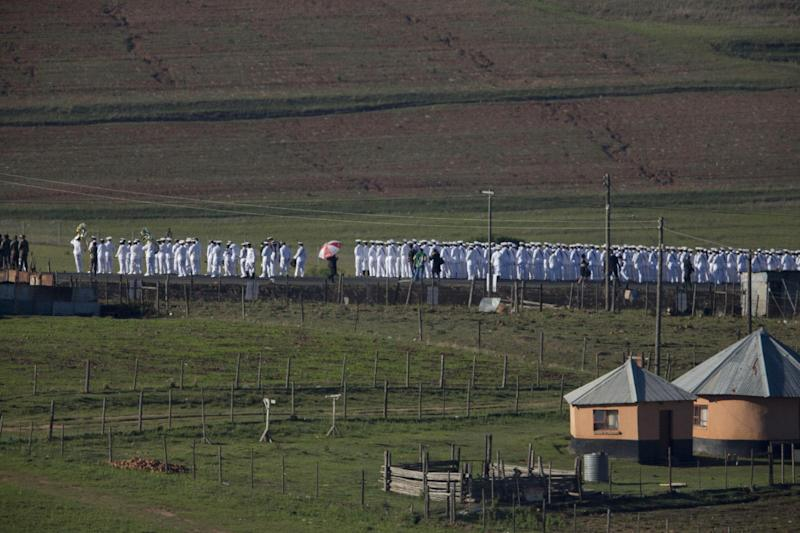 Members of the South African navy line the road from the Mandela family house to his burial site prior to the burial of former South African President Nelson Mandela in his hometown Qunu, South Africa, Sunday Dec. 15, 2013. (AP Photo/Peter Dejong)