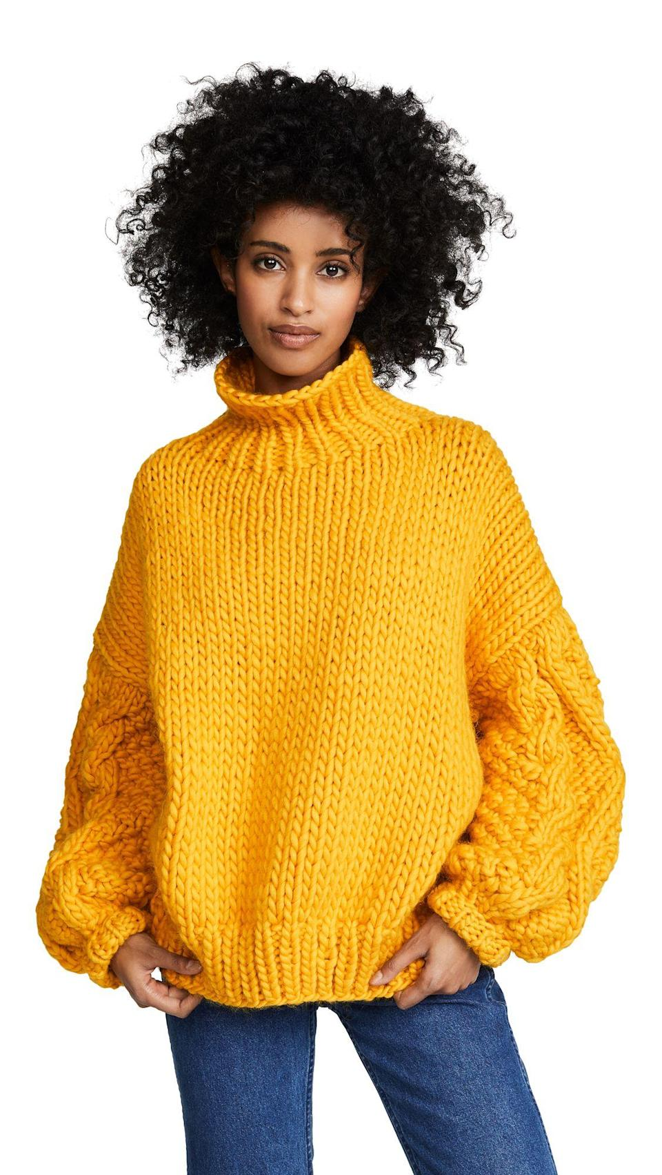 Start out with a chunky knit in an electric hue like this orange style.