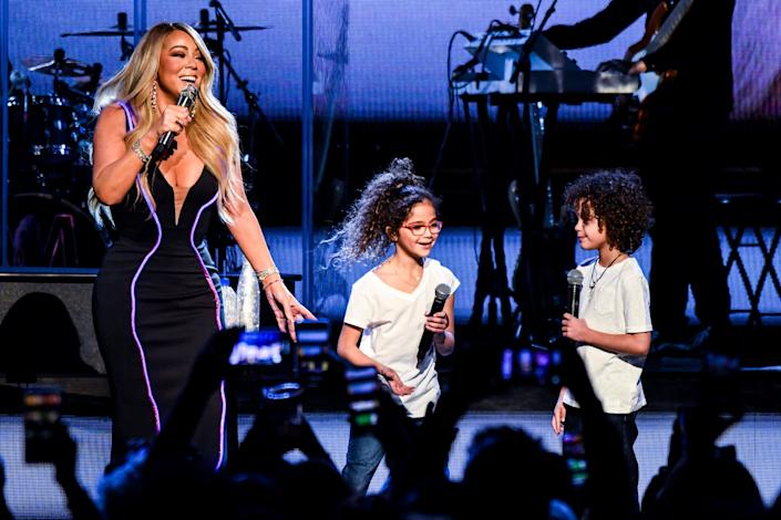 Mariah Carey performs with her kids Monroe Cannon and Moroccan Cannon during the the Caution World Tour in Atlanta, Georgia, in 2019. (Photo: Kevin Mazur via Getty Images)