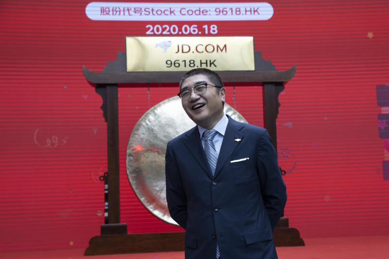 Xu Lei, head of JD Retail, reacts before the ceremony to mark the listing of JD.com on the Hong Kong Stock Exchange at the JD.com headquarters in Beijing on Thursday, June 18, 2020. Chinese e-commerce firm JD.com's stock jumped nearly 6% on its debut in Hong Kong on Thursday after the firm raised $3.9 billion in a share sale. (AP Photo/Ng Han Guan)