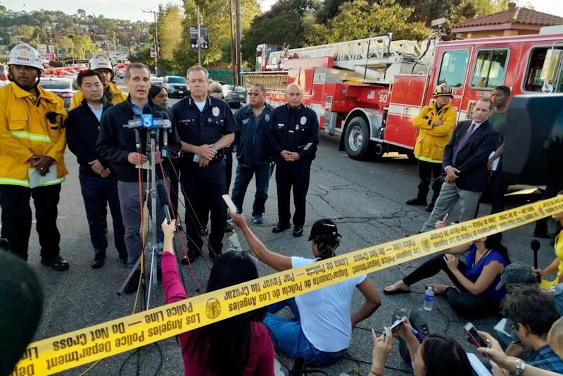L.A. Mayor Eric Garcetti (at microphone) speaks following what police called a hostage situation at a Trader Joe's in the the city's Silver Lake neighborhood, in which one woman was killed.