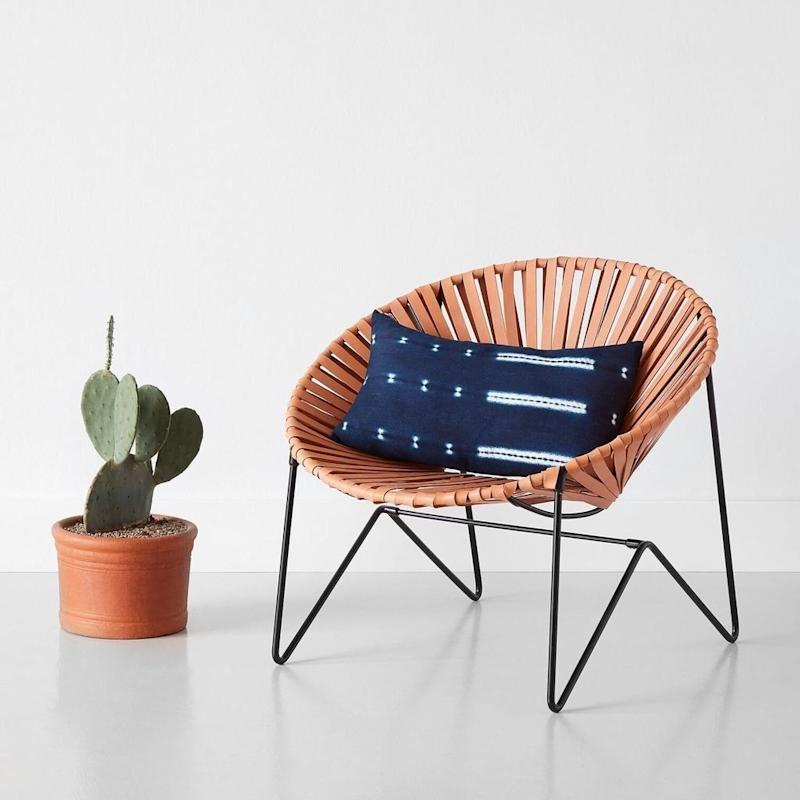 """Handcrafted in Mali, <a href=""""https://www.the-citizenry.com/collections/pillows/products/talari-indigo-lumbar-pillows"""" target=""""_blank"""">this pillow is made</a> by a fair-trade workshop in Bamako. If you didn't love it already, it has a rose gold zipper detail, too."""