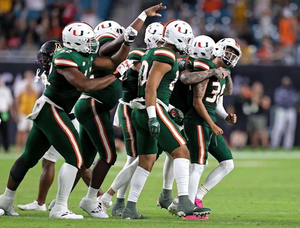 Miami Hurricanes place kicker Andres Borregales (30) celebrate with teammates after making a go-ahead field goal during the fourth quarter of their ACC football game at Hard Rock Stadium on Saturday, September 11, 2021 in Miami Gardens, Florida.