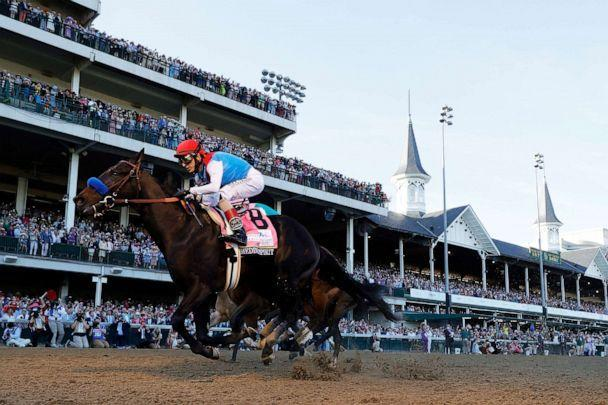 PHOTO: In this May 1, 2021, file photo, Medina Spirit #8, ridden by jockey John Velazquez, crosses the finish line to win the 147th running of the Kentucky Derby in Louisville, Ky. (Tim Nwachukwu/Getty Images, FILE)