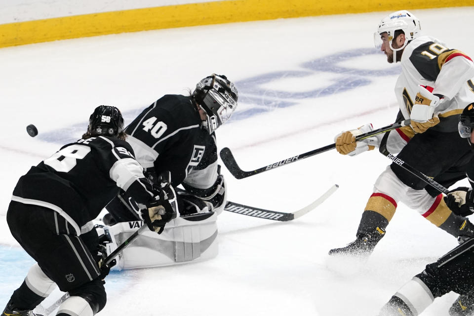 Vegas Golden Knights center Nicolas Roy, right, scores on Los Angeles Kings goaltender Calvin Petersen, center, as defenseman Kale Clague watches during the second period of an NHL hockey game Monday, April 12, 2021, in Los Angeles. (AP Photo/Mark J. Terrill)
