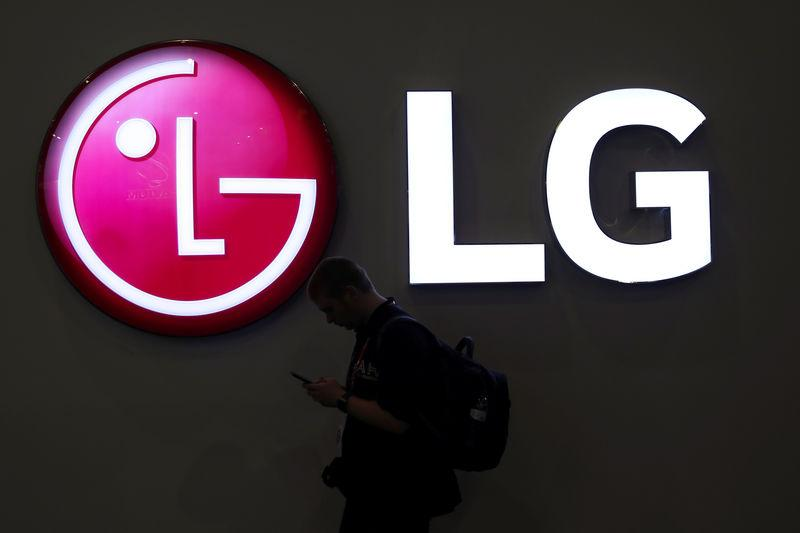 FILE PHOTO: A man walks past an LG logo at the Mobile World Congress in Barcelona