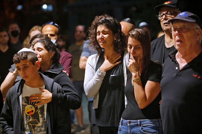 Mourners react during a funeral