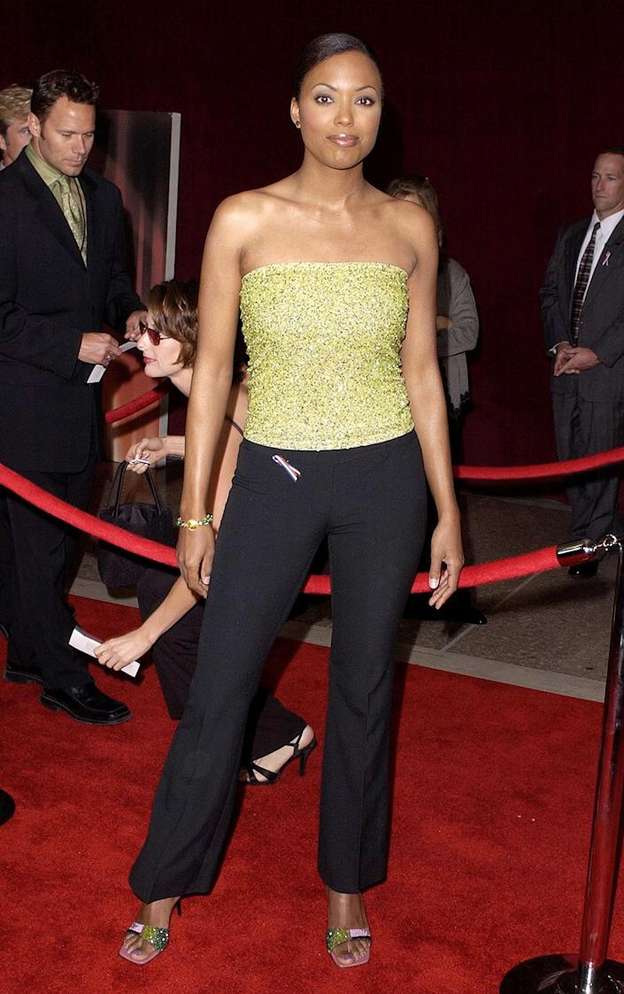 <p>Actress Aisha Tyler dressed down her red carpet look, rocking a sequined tube top and black slacks for the awards. </p>