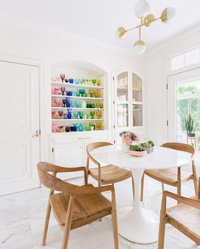 "<p>Here, a collection of rainbow glasses look more striking when they're displayed together. Not only does it keep them accessible and protected, it adds vivid colors to an otherwise neutral room.<br> </p><p>Oh, and rainbow color-coding your books and accessories can instantly organize a messy shelf.</p><p><a href=""https://www.instagram.com/p/CFsZUQ1BwS_/"" rel=""nofollow noopener"" target=""_blank"" data-ylk=""slk:See the original post on Instagram"" class=""link rapid-noclick-resp"">See the original post on Instagram</a></p>"
