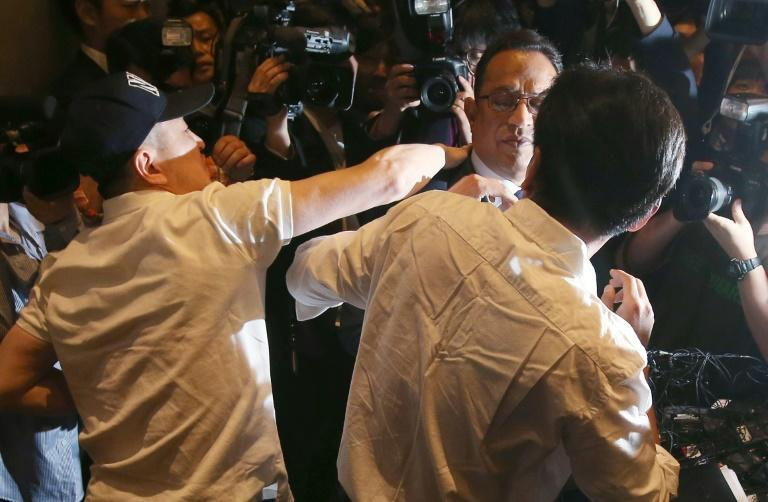 Atar Safdar (C), the head of Oxy Reckitt Benckiser Korea, is surrounded by angry relatives of victims during a press conference in Seoul, on May 2, 2016