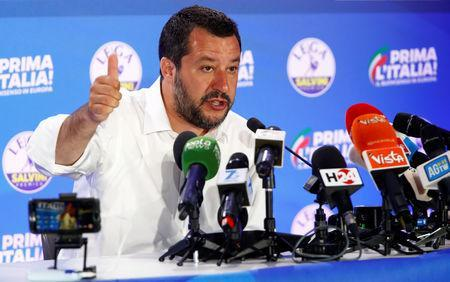 Deputy Prime Minister and League party leader Matteo Salvini speaks to the media at the League party headquarters, following the results of the European Parliament elections, in Milan, Italy May 27, 2019. REUTERS/Alessandro Garofalo