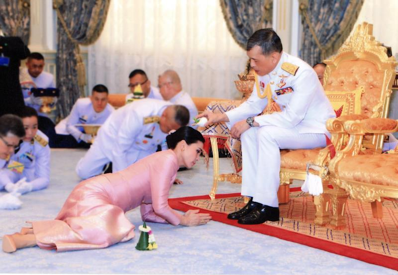 The Thai king Maha Vajiralongkorn pours wedding water on to Queen Suthida during a royal marriage registration ceremony at the Amphorn Sathan Residential Hall.