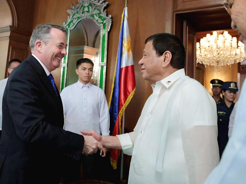 Liam Fox greets self-confessed murderer and international pariah President Duterte with a warm handshake (Rex)