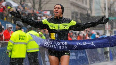 Desiree Linden of the U.S. crosses the finish line to win the women's division of the 122nd Boston Marathon in Boston, Massachusetts, U.S., April 16, 2018. REUTERS/Brian Snyder