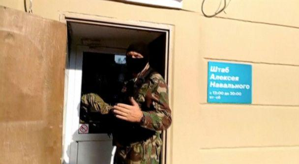 PHOTO: A masked law enforcement officer addresses journalists during a raid in a local office of Kremlin critic Alexei Navalny in Perm, Russia, Sept. 12, 2019, in a still image taken from a video. (59.RU via Reuters)