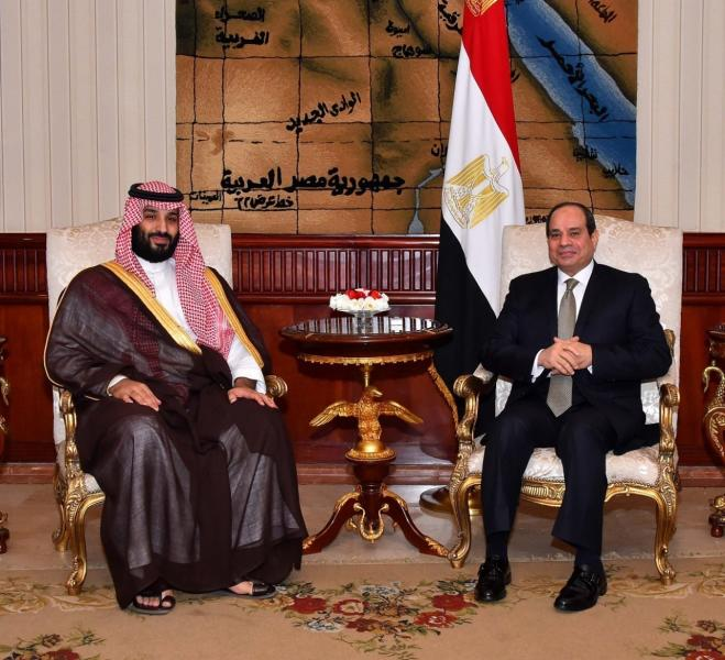 Egyptian Presidency's office Saudi Arabia's Crown Prince Mohammed bin Salman poses with Egyptian President Abdel Fattah El-Sissi in Cairo
