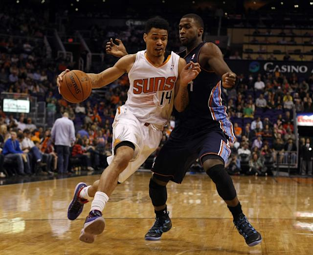 Phoenix Suns shooting guard Gerald Green (14) drives against Charlotte Bobcats small forward Michael Kidd-Gilchrist (14) in the fourth quarter during an NBA basketball game on Saturday, Feb. 1, 2014, in Phoenix. (AP Photo/Rick Scuteri)