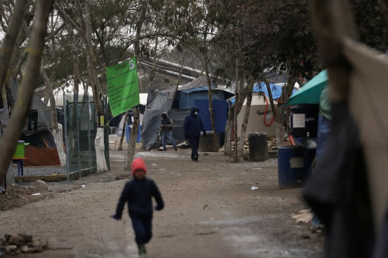 Asylum seekers are seen inside a migrant encampment in Matamoros