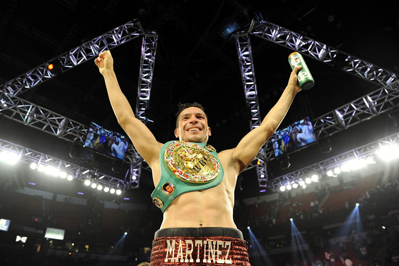 LAS VEGAS, NV - SEPTEMBER 15: Sergio Martinez celebrates after defeating Julio Cesar Chavez Jr. by unanimous decision after their WBC middleweight title fight at the Thomas & Mack Center on September 15, 2012 in Las Vegas, Nevada.  (Photo by Jeff Bottari/Getty Images)