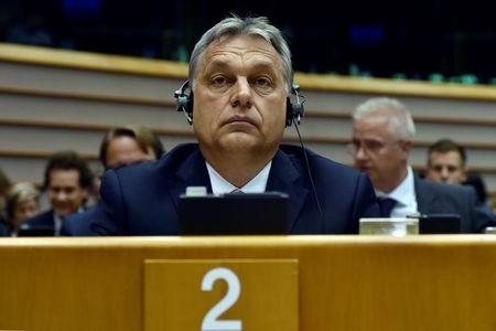 Hungary's PM Orban looks up during a plenary session at the EP in Brussels