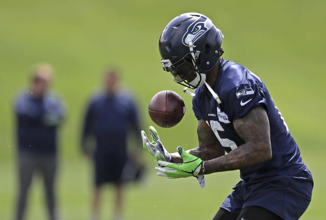Seattle Seahawks wide receiver Brandon Marshall makes a catch during NFL football practice, Wednesday, May 30, 2018, in Renton, Wash. (AP Photo/Ted S. Warren)
