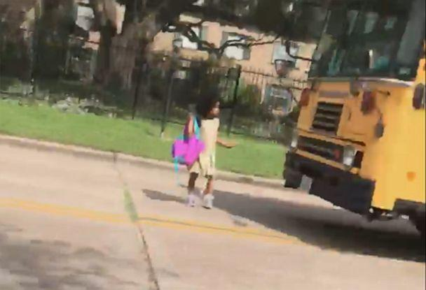 PHOTO: Houston mother Josephine Kirk-Taylor shared a video of a driver blowing past a yellow school bus' stop sign Wednesday and nearly striking her kindergarten-age daughter, Melina, as she got off the bus. (Courtesy Josephine Kirk-Taylor)