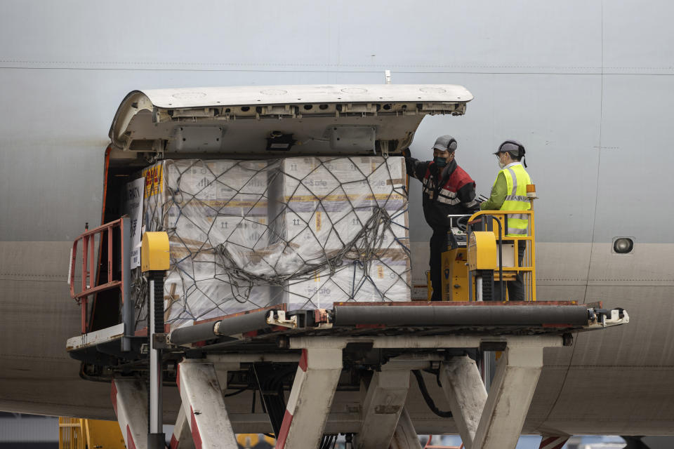 Boxes of the Pfizer-BioNTech coronavirus vaccines is unloaded from a Cathay Pacific cargo plane at the Hong Kong International Airport in Hong Kong, Saturday, Feb. 27, 2021. (Jerome Favre/Pool Photo via AP)
