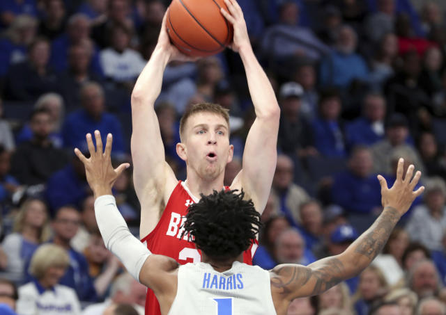 Memphis guard Tyler Harris (1) defends Bradley guard Nate Kennell (25) in the first half of an NCAA college basketball game Tuesday, Dec. 3, 2019, in Memphis, Tenn. (AP Photo/Karen Pulfer Focht)