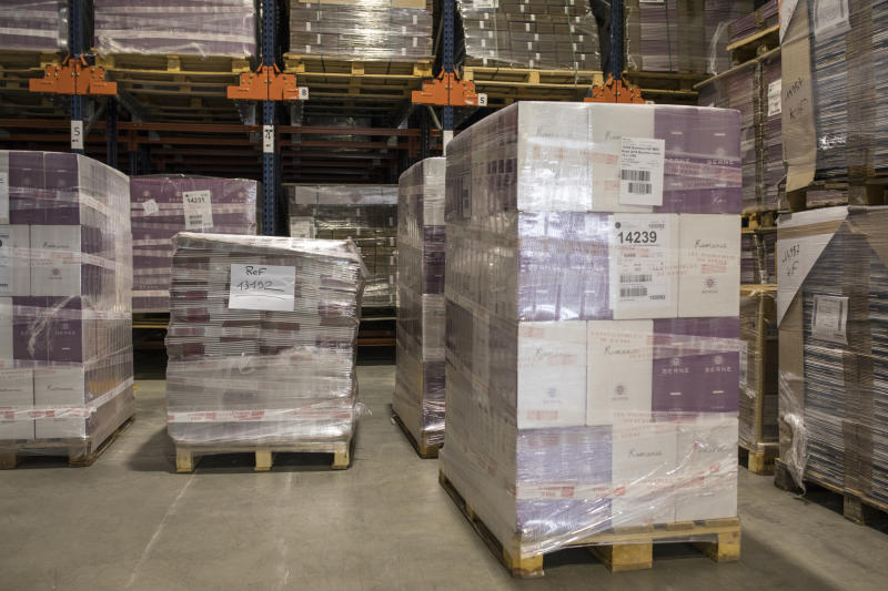 Wine cases ready for shipment sit in a warehouse in Le Cannet-des-Maures, in the Provence region, Thursday Oct. 10, 2019. European producers of premium specialty agricultural products like those protected at home for their territorial origin and sometimes centuries of artisanal know-how that fetch premium prices like French wine, are facing a U.S. tariff hike on Friday, dragged into a trade war over the fiercely competitive aerospace industry.(AP Photo/Daniel Cole)