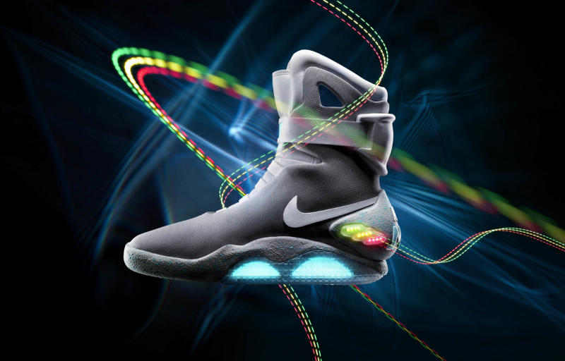 """This undated image provided by Nike, the 2011 Nike Mag is seen. Nike is going back to the future. The sneaker maker on Thursday, Sept. 8, 2011 said it has created a limited-edition shoe based on a glowing pair that appeared in the popular 1989 movie """"Back to the Future II."""" The 2011 Nike Mag is designed to be an exact replica of the fictional sneaker, including a glowing Nike name on the strap. But unlike the movie version, these shoes won't lace themselves. (AP Photo/Nike)"""