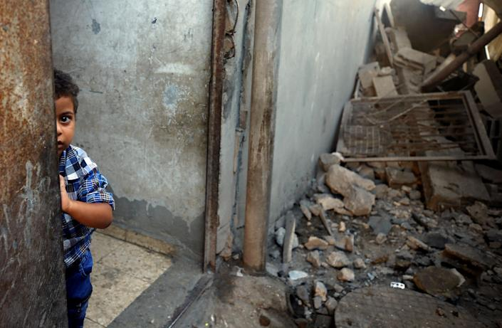 <p>A Palestinian boy looks out of his family's house that was damaged in an Israeli airstrike, in Al-Mughraqa on the outskirts of Gaza City, Aug. 9, 2018. (Photo: Mohammed Salem/Reuters) </p>