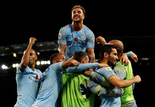 """Soccer Football - Premier League - Manchester City v Manchester United - Etihad Stadium, Manchester, Britain - November 11, 2018 Manchester City's Ilkay Gundogan celebrates scoring their third goal with teammates REUTERS/Darren Staples EDITORIAL USE ONLY. No use with unauthorized audio, video, data, fixture lists, club/league logos or """"live"""" services. Online in-match use limited to 75 images, no video emulation. No use in betting, games or single club/league/player publications. Please contact your account representative for further details."""