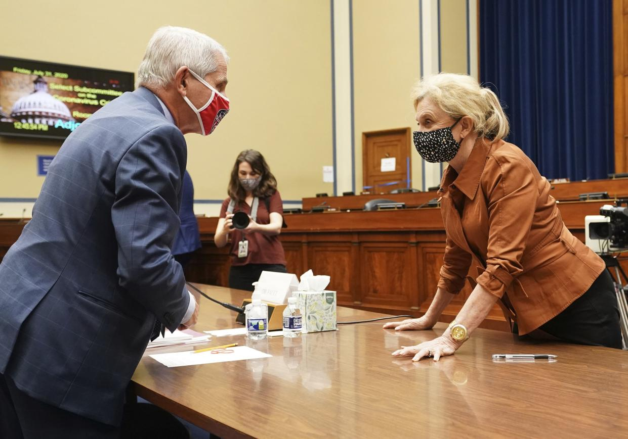 Dr. Anthony Fauci, director of the National Institute for Allergy and Infectious Diseases, speaks with Rep. Carolyn Maloney, D-N.Y., after a House Subcommittee on the Coronavirus crisis hearing, Friday, July 31, on Capitol Hill in Washington.