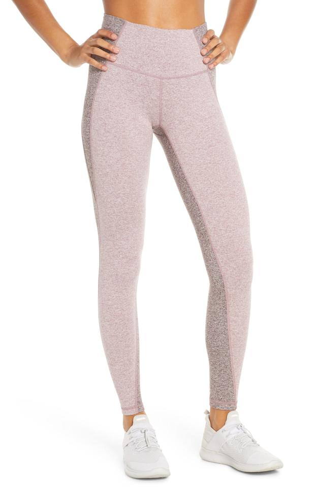 """<p>The colorblocking on these <a href=""""https://www.popsugar.com/buy/Zella-Rian-High-Waist-Ankle-Leggings-490893?p_name=Zella%20Rian%20High%20Waist%20Ankle%20Leggings&retailer=shop.nordstrom.com&pid=490893&price=65&evar1=fit%3Aus&evar9=44234490&evar98=https%3A%2F%2Fwww.popsugar.com%2Fphoto-gallery%2F44234490%2Fimage%2F46618880%2FZella-Rian-High-Waist-Ankle-Leggings&list1=workout%20clothes%2Cleggings%2Cworkouts%2Cfitness%20gifts%2Cactivewear%2Cgifts%20for%20women&prop13=api&pdata=1"""" rel=""""nofollow"""" data-shoppable-link=""""1"""" target=""""_blank"""" class=""""ga-track"""" data-ga-category=""""Related"""" data-ga-label=""""https://shop.nordstrom.com/s/zella-rian-high-waist-ankle-leggings/5242757?origin=category-personalizedsort&amp;breadcrumb=Home%2FWomen%2FClothing%2FActivewear%2FPants%2C%20Leggings%20%26%20Capris&amp;color=purple%20shake%20melange"""" data-ga-action=""""In-Line Links"""">Zella Rian High Waist Ankle Leggings</a> ($65) is so flattering.</p>"""