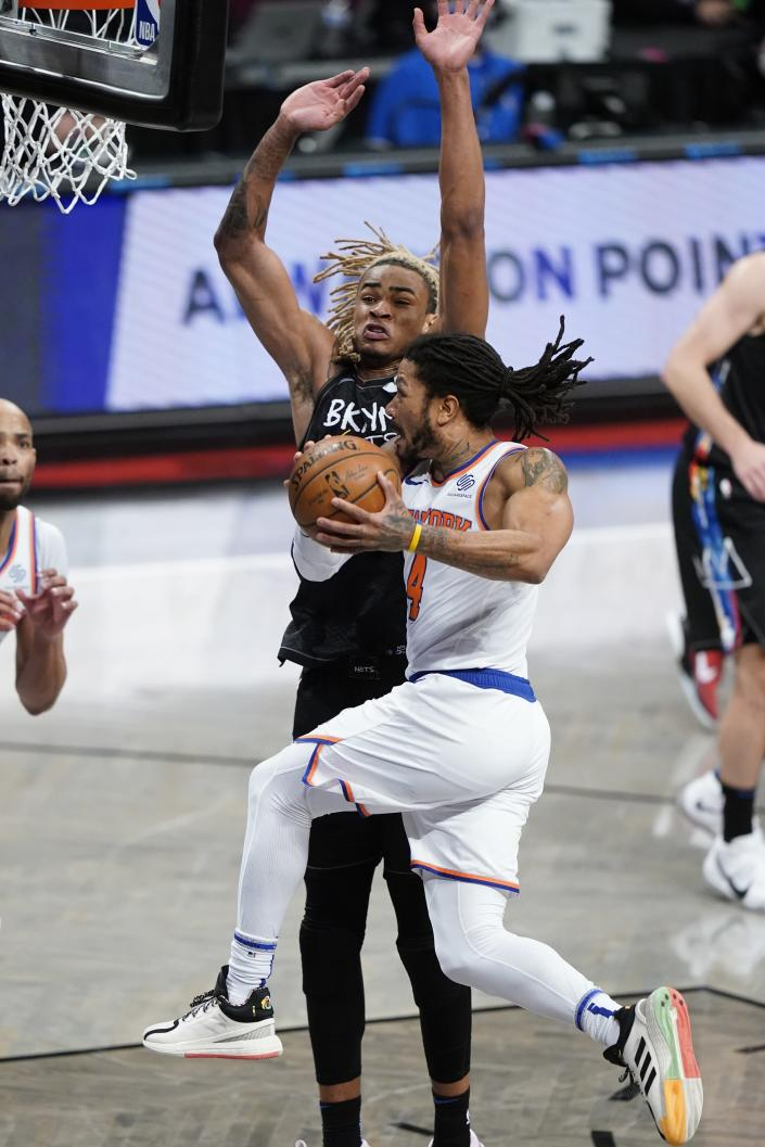 New York Knicks' Derrick Rose (4) drives past Brooklyn Nets' Nicolas Claxton (33) during the second half of an NBA basketball game Monday, April 5, 2021, in New York. (AP Photo/Frank Franklin II)