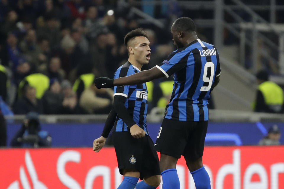 Inter Milan's Romelu Lukaku, right, celebrates with Inter Milan's Lautaro Martinez after scoring his side's opening goal during the Champions League, group F soccer match between Inter Milan and F.C. Barcelona, at the San Siro stadium in Milan, Italy, Tuesday, Dec. 10, 2019. (AP Photo/Luca Bruno)