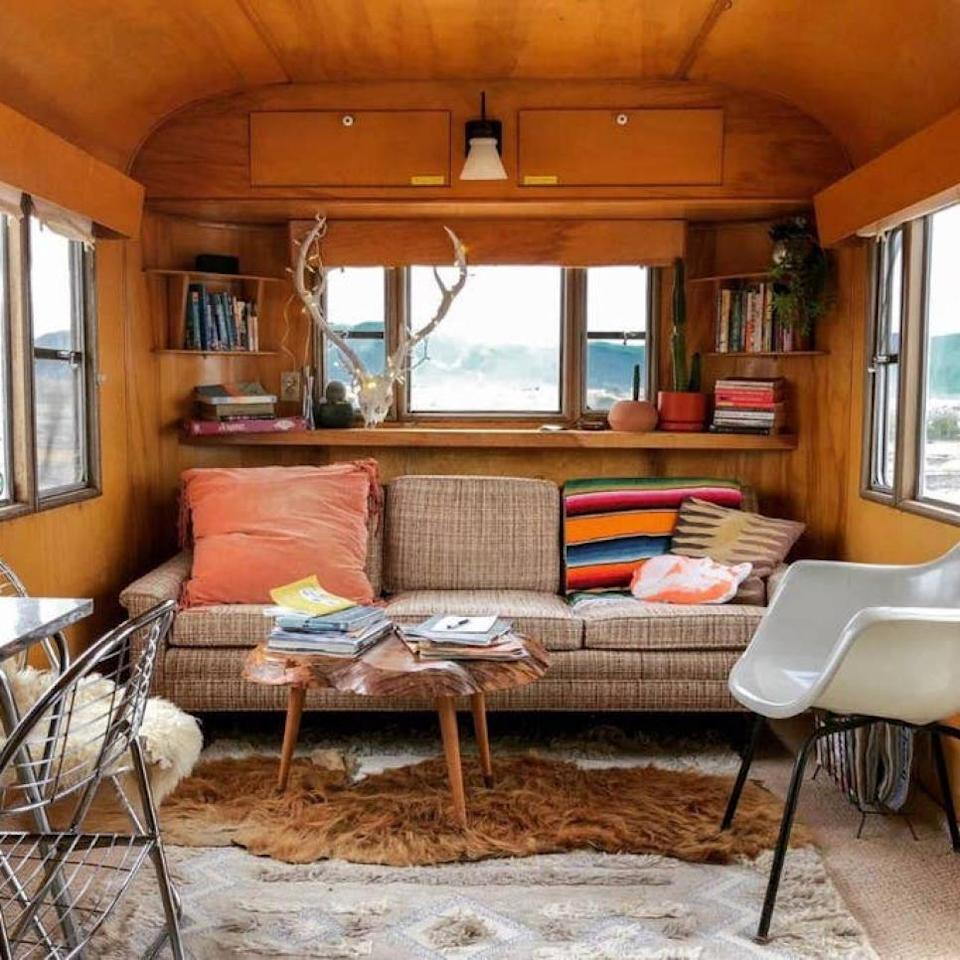 """<p>This 1954 Silver Dome travel trailer is not an Airstream, but it has a charm of its own, starting with the bright yellow exterior. The inside is decorated to match the dusty orange and pink New Mexico sunsets, with a cozy living area, fully-functioning kitchen, full-sized bed, and bathroom with both a tub and shower inside. For more sleeping space, the sofa pulls out into a bed. It sits just outside downtown Taos, and shares a yard with the owner's home (a shiny silver 1957 Spartan Imperial Villa). You'll want to spend evenings outside—there's plenty of seating, as well as multiple fireplaces to keep you warm or roast a marshmallow.</p> <p><strong>Book now:</strong> <a href=""""https://airbnb.pvxt.net/E717D"""" rel=""""nofollow noopener"""" target=""""_blank"""" data-ylk=""""slk:From $68 per night, airbnb.com"""" class=""""link rapid-noclick-resp"""">From $68 per night, airbnb.com</a></p>"""