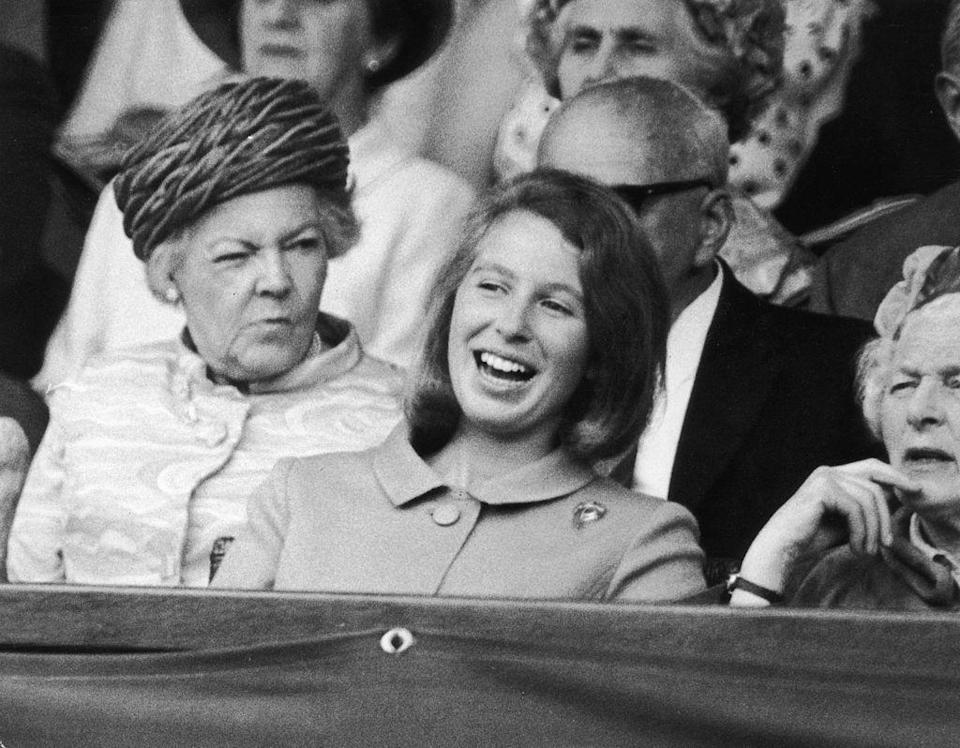 <p>Princess Anne is spotted laughing in the crowd.</p>
