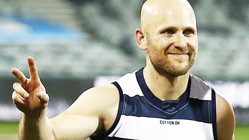 Geelong AFL player Gary Ablett is pictured walking off the field.