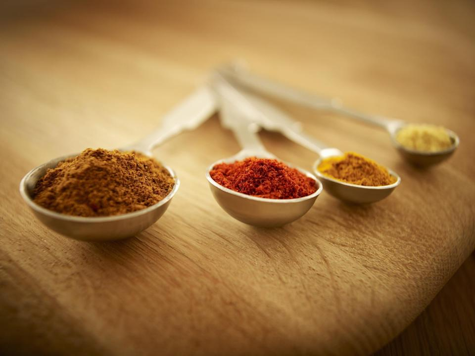 """<p>You may have had that small container of oregano in your cupboard for years and years, but it might be time <a href=""""https://www.thedailymeal.com/cook/marie-kondo-spice-drawer?referrer=yahoo&category=beauty_food&include_utm=1&utm_medium=referral&utm_source=yahoo&utm_campaign=feed"""" rel=""""nofollow noopener"""" target=""""_blank"""" data-ylk=""""slk:to clean out your spice cabinet"""" class=""""link rapid-noclick-resp"""">to clean out your spice cabinet</a>. Believe it or not, spices can go bad. When spices expire, they start to lose flavor. If you store them correctly, however, you can hold on to those scrumptious spices for longer. Make sure that your spices aren't anywhere near your oven or stove. Heat can cause spices to dry out, and water vapor from the stove can infiltrate spice containers and cause them to clump. Instead, choose a cool, dry place that isn't exposed to sunlight like a cabinet or drawer. Ensure that your spices are stored in an airtight container. You might purchase your own small glass containers or simply use plastic bags.</p>"""