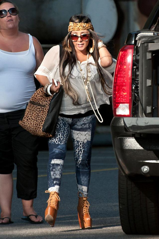 Speaking of tacky ... check out what Snooki was seen wearing while out and about in New Jersey earlier this week. Which element of the mom-to-be's ensemble do you find most cringe-inducing: her Steven Tyler-inspired headscarf, bold patterned pants, or sky-high platform booties? (5/29/2012)